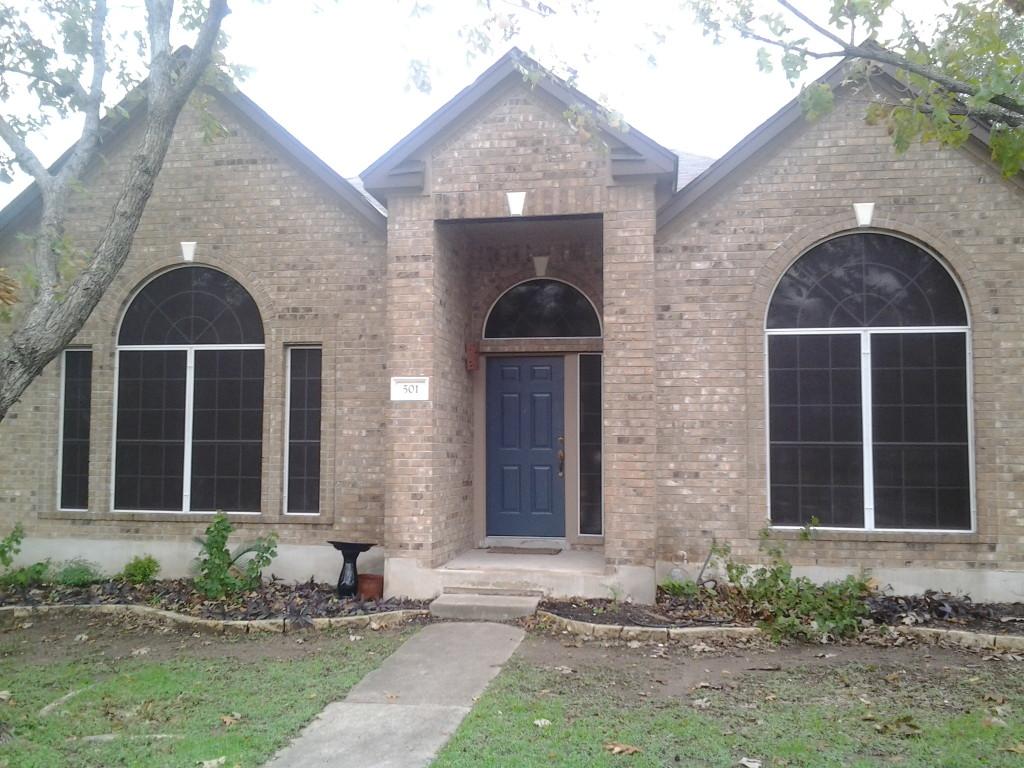 Fixed solar window screens on an Austin TX home.